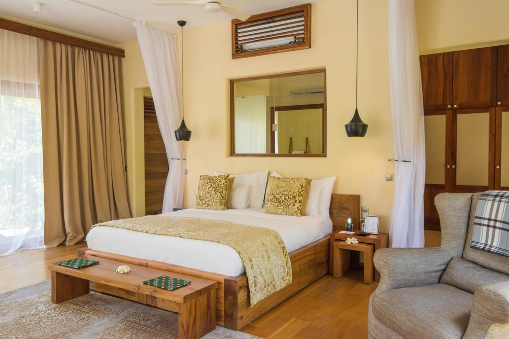 Кровать или кровати в номере Zanzibar White Sand Luxury Villas & Spa - Relais & Chateaux